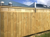 Vertical paling fence with horizontal slat top and cap board