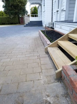 Wooden steps to decking and paving area