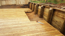 Deck with retaining wall and cute outing deck for a raised garden
