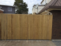 Vertical fence using dressed 68 x 19 H3 timber and dressed cap board