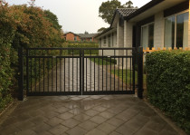 Twin driveway gates made from aluminium.