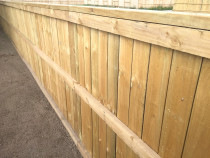 Paling fence inset between posts at front and this is the reverse side