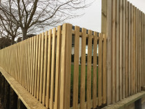 Open Picket Fence with dressed timber joint to a solid side fence