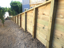 Retaining wall using tongue and groove timber with 125 x 125 square posts