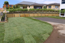 Instant lawn turf against retaining walls