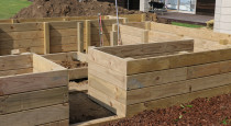 Building Raised garden boxes with internal walkway2