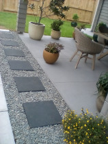 Paving stone walkway footpath with ornamental riverstone surround