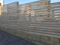 Horizontal slat fence using dressed decking timber.