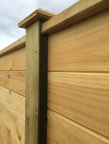 Horizontal fence using tongue and groove timber for solid timber finish with post caps