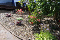 Garden layout and planting, weed mat and ornamental riverstone