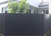Hardiplank solid fence painted black.