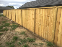 Paling fence inset between posts face side