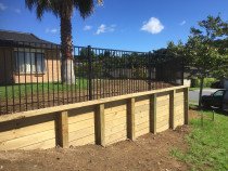 Retaining walls using tongue and groove timber with 125 x 125 square posts and open aluminium security fencing