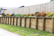 Retaining wall with garden on top then paling fence set back for security