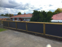 Boundary fence using horizontal colour steel