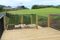Deck with open aluminium security fence panels