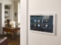 Control4 on wall touchscreen - This awesome unit allows you to control multiple things within your home. Dim your lights, turn the TV & speakers on plus even use it as you intercom video screen!