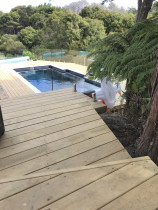 Pool Deck (Part 3) by Top 2 Bottom Carpentry Ltd - View showing the steps leading down to the new pool deck. 