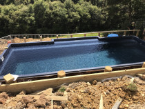 Pool Decking by Top 2 Bottom Carpentry Ltd - This was a great job that we started in Orewa, we excavated the area into the slope, drilled holes and fitted piles, and installed a huge fantastic Deck around the pool with steps leading back up to the house. (Part 1)
