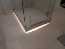 Shower base lighting by TopMark Electrical - TopMark Electrical are able to offer interesting lighting features to our clients offering style and functionality to any space.