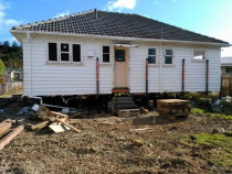 Repiling, addition and general renovation by Vert Construction Ltd - Repiled the the house, added 2 bedrooms and internal access garage.  Reclad, reroof and general interior and exterior renovations in Wainuiomata.