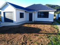 Repiling, addition and general renovation by Vert Construction Ltd - Repiled the the house, added 2 bedrooms and internal access garage.  Reclad, reroof and general interior and exterior renovations in Wainuiomat