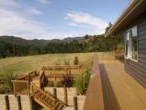 New build- Te mata byVista Construction Limited - Deck with stairs leading down to lower level over large retaining wall