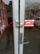 Double Lock Block - Western Lock Services Ltd - Double lock block securing a commercial entry door
