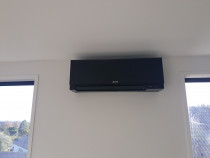 Heat pump supply and installed by Your Local Sparky Ltd - Beautiful in black,Mitsubishi designer series makes the wall look better