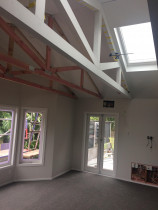 Hillcrest North Shore - Something different, raised floor in split level house, opened up ceiling with exposed trusses with new timber joinery and total refurb throughout.