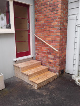 Step renewal - Law Landscapes completed a small step renewal on a rental property. Steps are built from 140x32 decking for the treads and H4 timber for internal frame. We also installed a round handrail along the brickwall