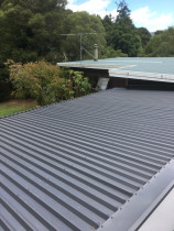 Re roofing in stoked valley - Re pitch and re roofing of a flat roof