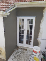 Exterior plastering works - Remedy Exterior plastering works on installing New door position, done,
