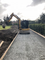 Driveway Preparation - Excavating and spreading aggregate in preparation for a new concrete driveway