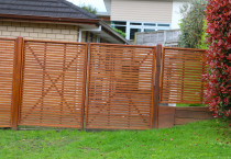 Slat trellis double gates as boundary fence