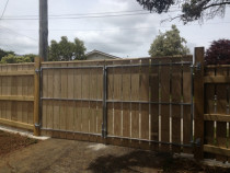 Gauged timber panels screwed to steel frame gate by Absolute Fencing
