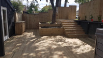 Landscaping decking with stairs and planter box by AJ & SJ Contractors
