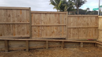 Retaining wall with fence ontop by AJ & SJ Contractors