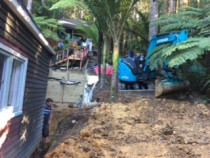 We are making our way down the hill to make access for stage two of the retaining wall - AJLC Excavation - This was a very tricky site to work on, as it was very steep and dangerous.