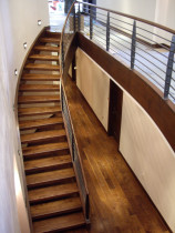 AMW Builders Ltd - Mt Laurel project Walnut stair and custom black Iron forged balustrade