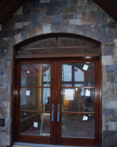AMW Builders Ltd - Laurel Job - Mahogany entrance double door with baldwin hardware, Stone masonry custom blend of 125mm