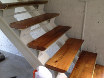 Angus Builders Ltd - Kauri and brass stair treads made from recycled joists