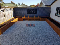 Landscaping overhaul - A.S. Building Ltd - A beautiful outdoor space! Raised garden beds, fire pit pad and stone pebbles