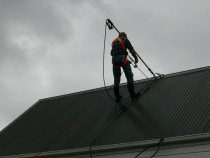 Being very careful up here , safety first at Auckland Exterior Cleaning Ltd