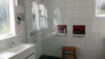 4 - Bathroom completed by Auckland Villa Restorations Ltd - The rear door was removed and the floor was tapered for the fall in the walk in shower.
