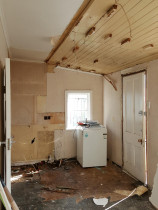 5 - Kitchen upgrade by Auckland Villa Restorations Ltd - Strip out all fittings, install TVG paneling to ceilings. Re-locate back door