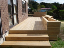 Hillcrest Deck Project .by Built Rite Construction 2010 Ltd - This is a large new deck we completed recently , including bench seating , planter boxes and boxed in steps .