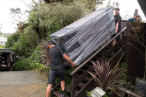 Cameron Ryan Transport | I've got this! - This piece is as long as the stairs it's coming down, the guys have it blanketed and wrapped for protection. Notice Murray in the background running up the hill to help - Tight team!