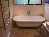 Free standing bath - Cleanline Bathrooms Ltd - tiled floor and walls