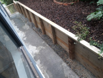New retaining wall by CN Builders - New retaining wall with handrail & balusters down stairway